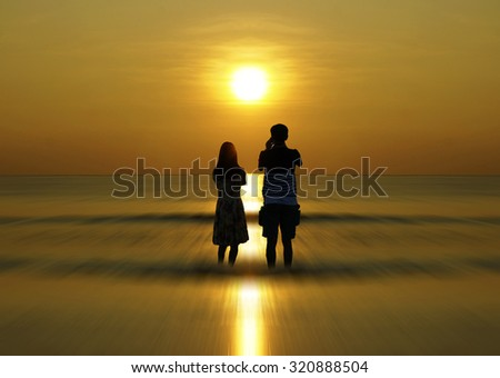Silhouette of couple watching when sun rising up                               - stock photo