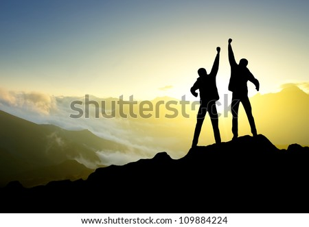 Silhouette of couple winners on sky background. Sport and active life - stock photo