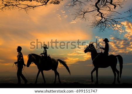 silhouette of cowboy on horse against cloudy evening sky on sunset