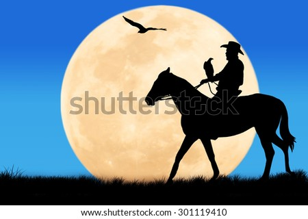 silhouette of Cowboy sitting on his horse at full moon  background - stock photo