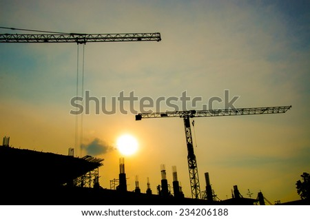 silhouette of crane for construction building - stock photo