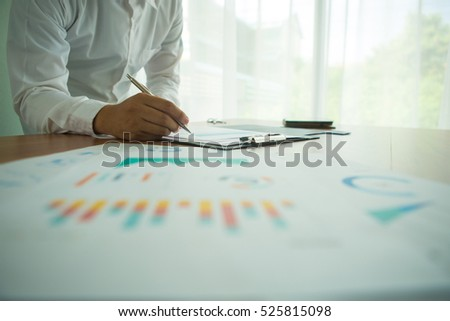 Silhouette of cropped shot of businessman hand working and business strategy as concept,selective focus,flare light