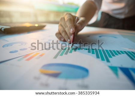 Silhouette of cropped shot of businessman hand working with new modern computer and business strategy as concept,selective focus,flare light - stock photo