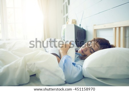Silhouette of cropped shot of Sleeping, Women, Bed,flare light - stock photo