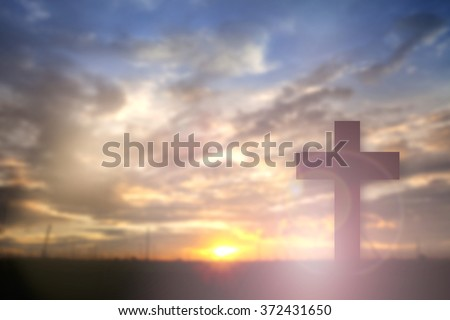Silhouette of Cross over sunset concept for religion, worship, Christmas, Easter, thanksgiving prayer and praise. - stock photo