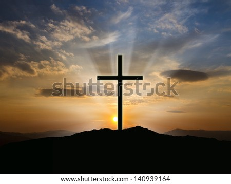 Silhouette of crosses at  sunrise or sunset with light rays. - stock photo