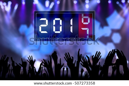 Silhouette of crowd hands people celebrate new year and count down time with number 2017