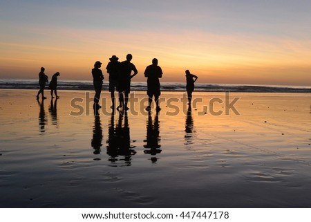 Silhouette of Crowd on Beach at Sunset