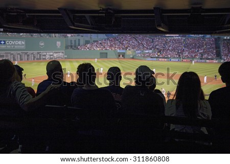 Silhouette of crowd watches baseball game at historic Fenway Park, Boston Red Sox, Boston, Ma., USA, May 20, 2010, Red Sox versus Minnesota Twins, attendance, 38,144, Red Sox win 6 to 2 - stock photo