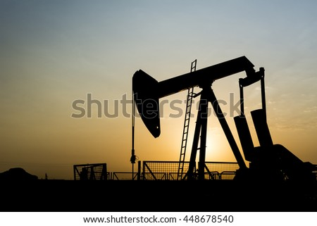 Silhouette of crude oil pump in the oilfield