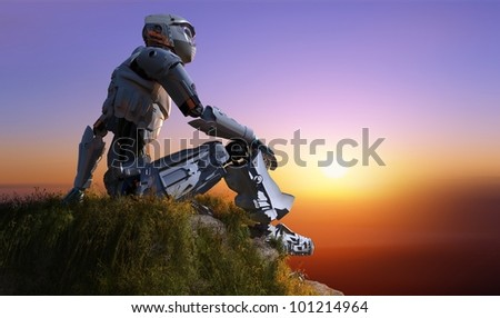 Silhouette of cyborg in a landscape - stock photo