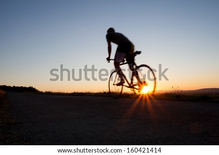 silhouette of cyclist  - stock photo