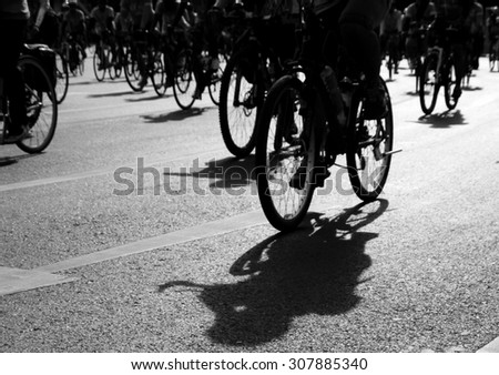 Silhouette of cyclists at sunrise - stock photo