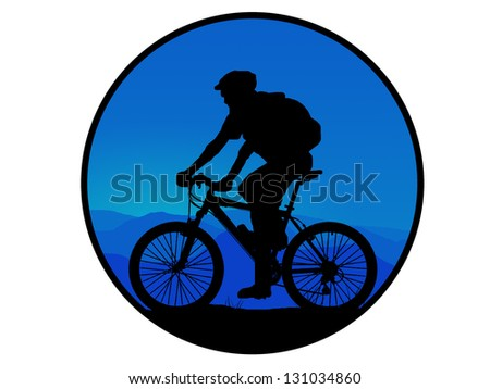 silhouette of dark mountain biker - stock photo