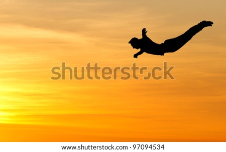 silhouette of diver in sunset - stock photo