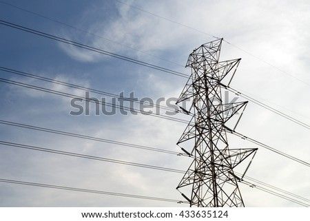 Silhouette of electricity post in evening day.High voltage power line.