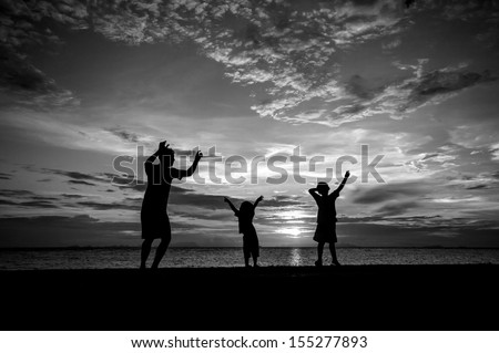 silhouette of family at dusk. black and white.