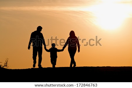 silhouette of family on the outdoor at dusk.