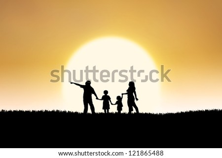 Silhouette of family walking on the field under the sunset