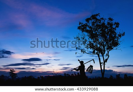 Silhouette of farmer pointing at sky for dreaming. Dark tone.