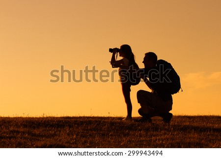Silhouette of father and daughter hiking together.Father and daughter hiking - stock photo