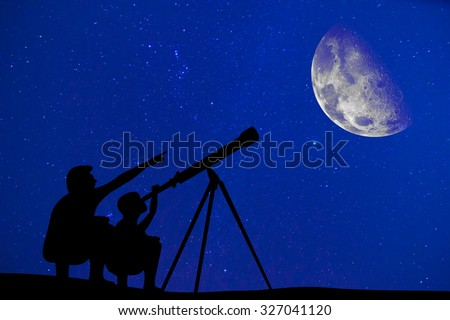 Silhouette of father and son looking moon through a telescope at the beautiful night sky  Elements of this image are furnished by NASA - stock photo