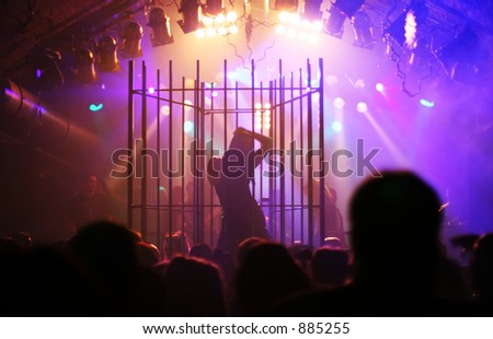silhouette of female dancer in a steel cage