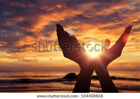 silhouette of female hands during sunset. Concept of life