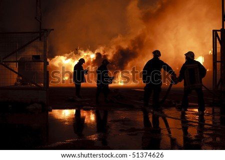 Silhouette of firefighters - stock photo
