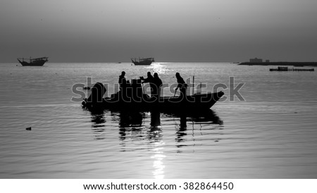 Silhouette of fisher men going for fishing in the morning hours - Bahrain - Black and white