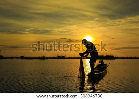 silhouette of fisherman against the sunrise. silhouette.