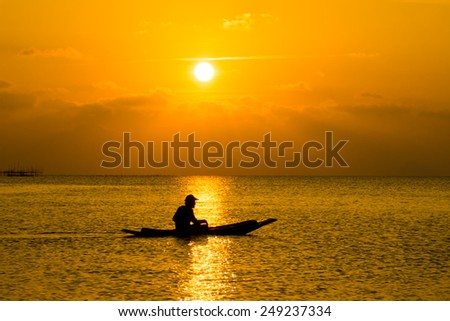 silhouette of fishermen in a boat.