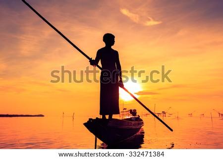 silhouette of fishermen, Talay Noi, Phatthalung Province, Thailand  - stock photo
