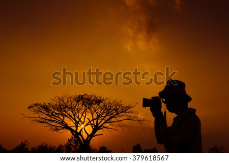 silhouette of freedom photographer action with camera in sun set