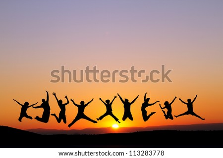 silhouette of friends jumping in sunset for fun