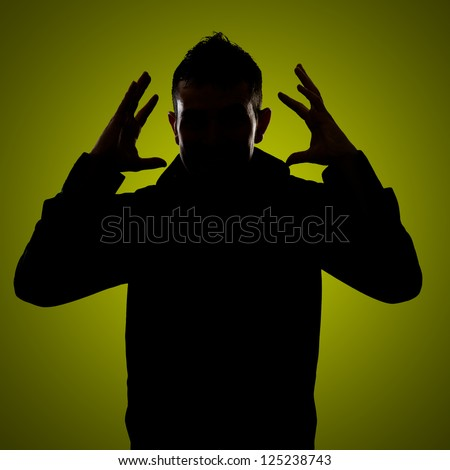 Silhouette Of Frustrated Man Isolated On Green Background