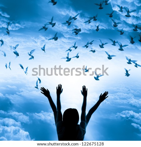 Silhouette of girl and flying dove on sky blue tone background, freedom and peace concept