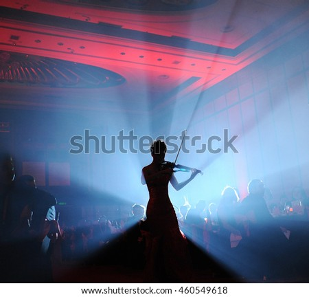 silhouette of girl and playing music instruments