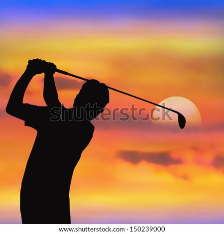 silhouette of golf player at sunset - stock photo