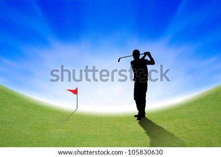 Silhouette of Golfer on green and blue sky - stock photo