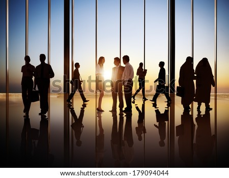 Silhouette of Group of Busy Business People - stock photo