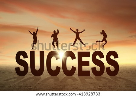 Silhouette of happy businesspeople jumping over a text of success at sunset time