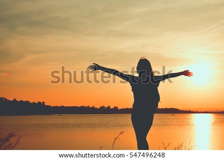 Silhouette of happy women relax in the nature concept travel at the sunset