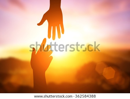 silhouette of helping hand concept - stock photo
