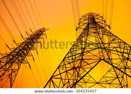 Silhouette of high voltage post in the evening