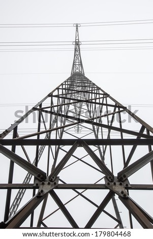 Silhouette of high voltage power line - stock photo