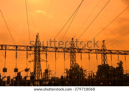 Silhouette of high voltage power lines - stock photo
