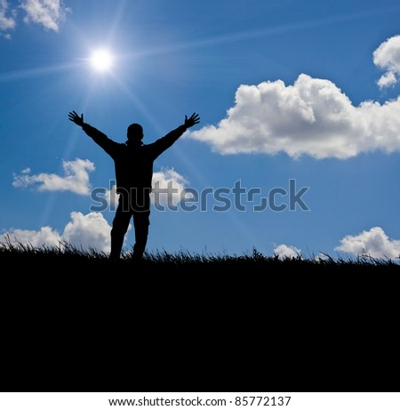 Silhouette of  hiker in mountain open his arms for the sun