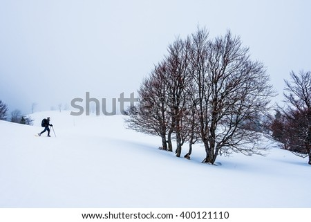 Silhouette of hiking woman in Velka Fatra mountains, Slovakia snowshoe trip