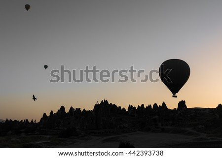 Silhouette of hot air balloon at sunrise in Cappadocia, UNESCO world heritage in Turkey